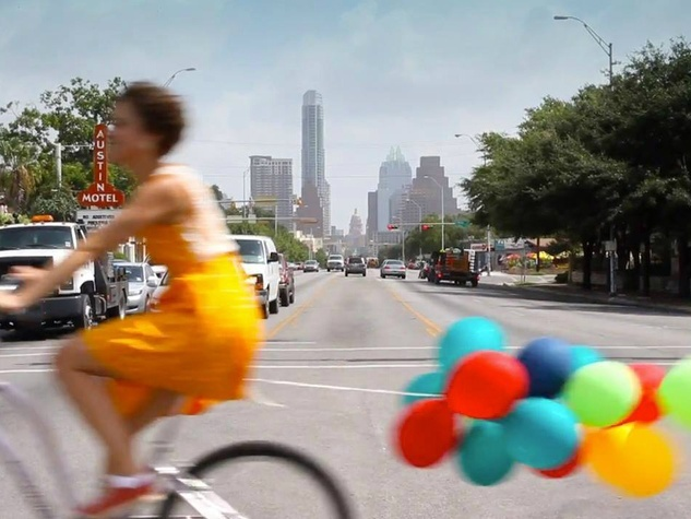 Amplify-Austin-funraiser-woman-bike-bicycle-baloons-South-Congress-Avenue_145002
